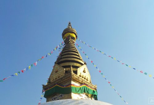 Colourful Swayambhu Stupa with flags in Kathmandu, Nepal