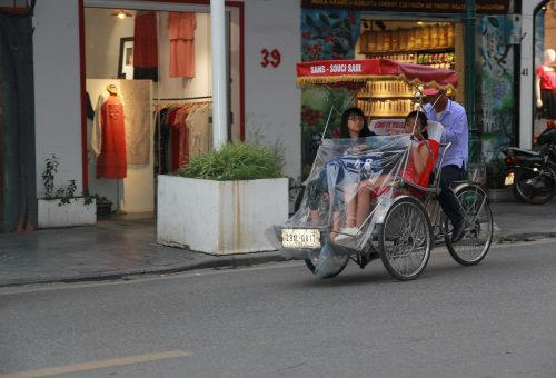 Women sitting on a cyclo in Vietnam