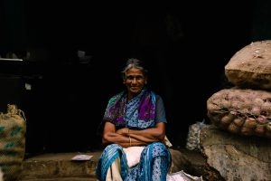 Indian women sitting and smiling