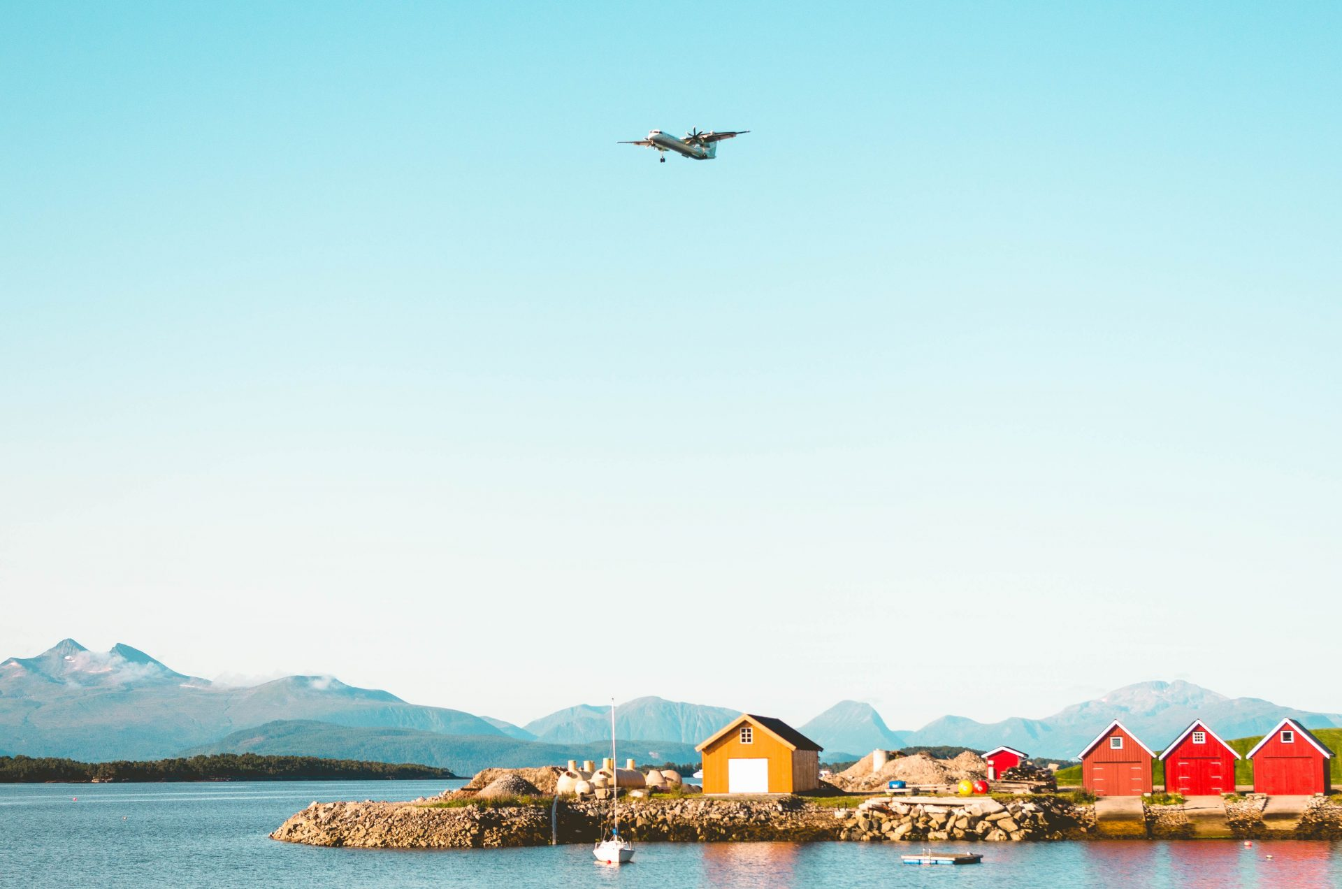 Plane flying over the fjord in Molde in Norway