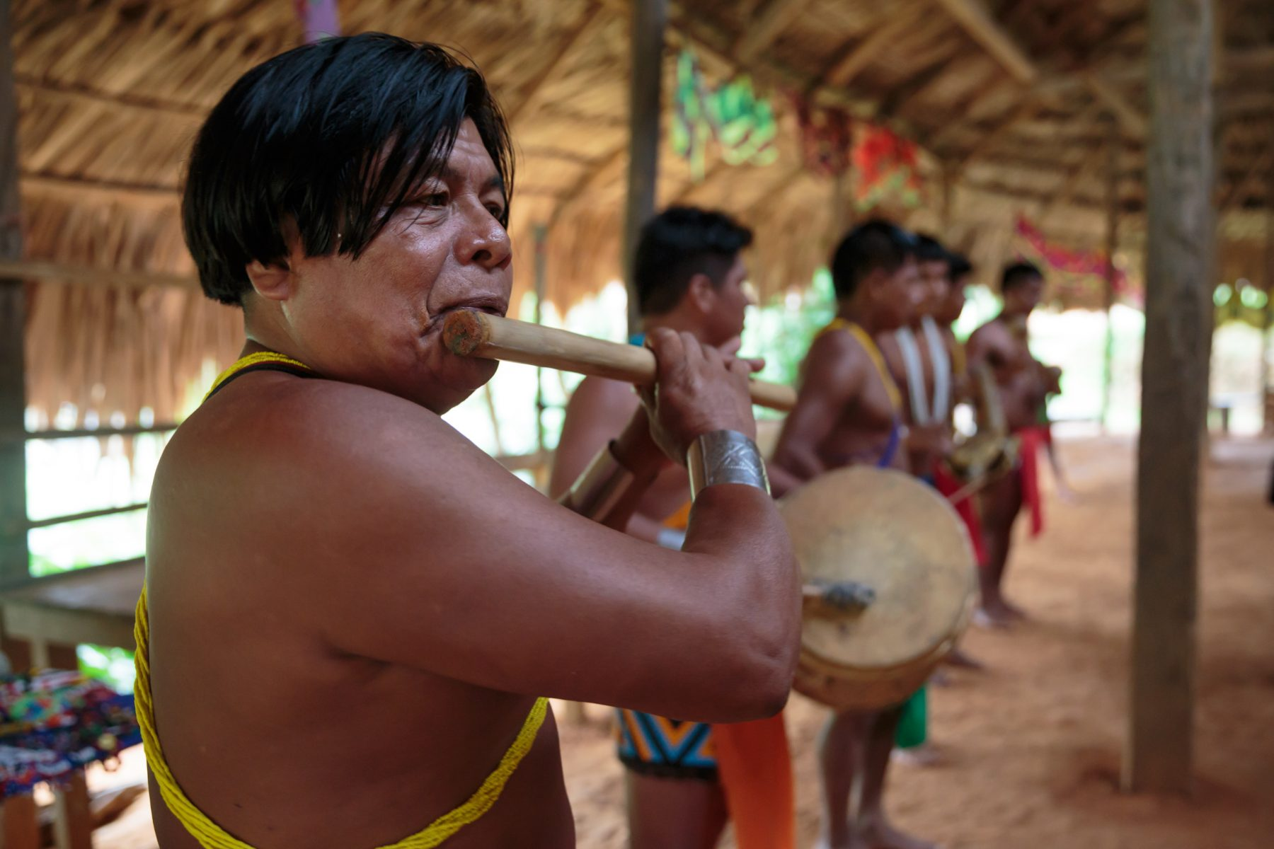 Indigenous men playing traditional instruments