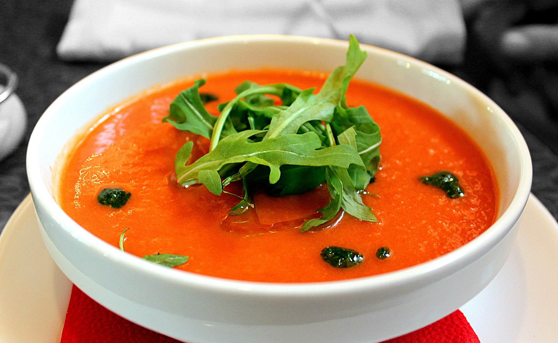 Tomato soup with rocket and olives